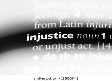 injustice word in a dictionary. injustice concept.