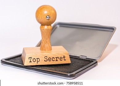 Ink pad and stamp with the words Top Secret