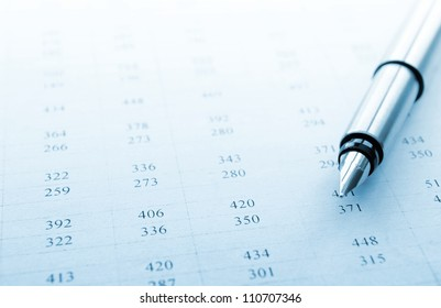 ink pen and documents with the records for business