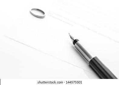 Ink pen on divorce papers. Concept of divorce.