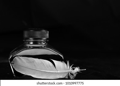 Ink pot and feather