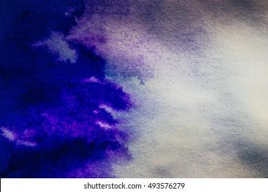 ink spot spreads on paper blue color