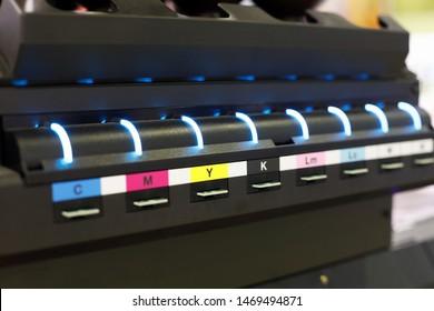 Ink supply unit of large format flatbed inkjet printer. Selective focus.