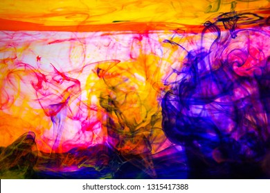 Ink in water. Abstract background. Ink swirling in water. Colorful ink in water. Underwater photo