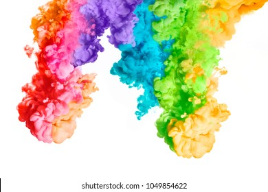 Ink in water isolated on white background. Rainbow of colors. Color explosion