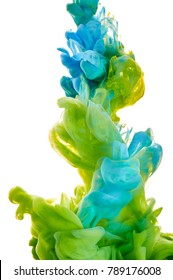 ink in the water. A splash of green and blue  paint. Abstract background color