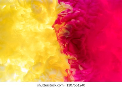 Ink in the water. A splash of pink and black paint. Abstract background color