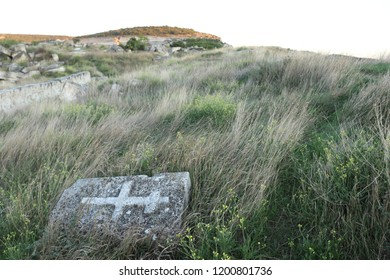 INKERMAN, REPUBLIC OF CRIMEA / RUSSIA - SEPTEMBER 18 2018: Old desecrated graves near medieval Byzantine Kalamita fortress at Crimea