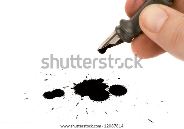 Ink-pen and ink blot isolated on white background