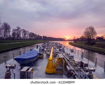 Inladn ship tanker with gas transportation on the Wesel Dateln canal by Hunxe Germany March 2017, binnenvaart inland shipping sunrise