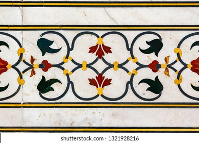 Inlaid semi precious stones decorate the walls of the Taj Mahal
