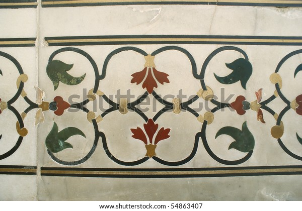 Inlaid in white marble and colored stone at the Taj Mahal