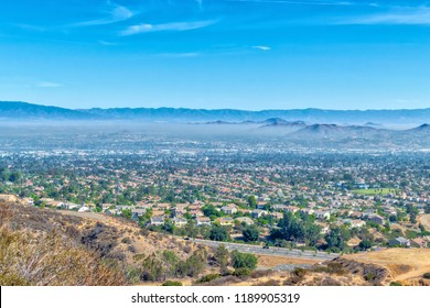 Inland empire of California with hills and homes in distance with sky for copy text