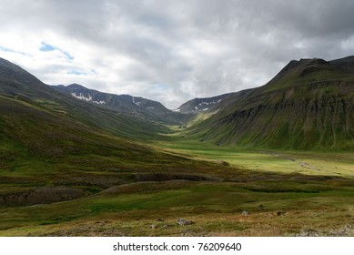 inland mountains and pristine lawns of Akureyri in Iceland