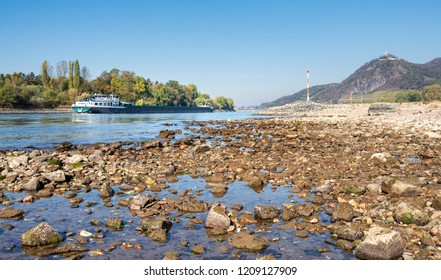 Inland navigation vessel with reduced shipload on dried out river Rhine with low water level, caused by prolonged drought 2018, by Bad Honnef and Drachenfels, North Rhine-Westphalia, Germany, Europe