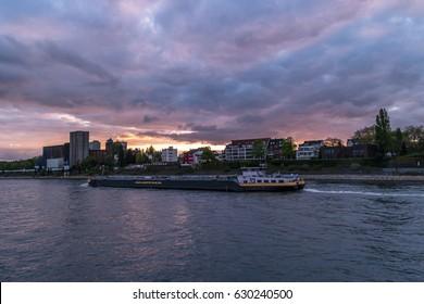 Inland shipping tanker vessel boat on the rhein river with sunset clouds,By Duisburg Germany April 2017,inland ship, binnenvaart , cargo transport,binnenschiff