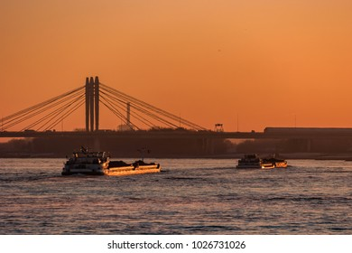 Inlandshipping during sunset Netherlands waal river rijn