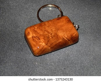 Inlay keychain made of oak wood against the night sky