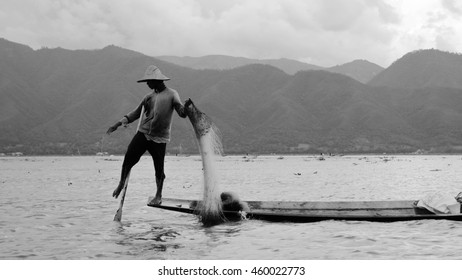 inle fisherman fishing in burma black and white