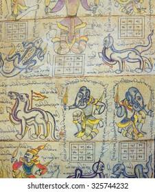 INLE LAKE, BURMA - MAR 1, 2015  - Astrological chart on Burmese calendar showing guardian spirits and mythical animals, Myanmar, Burma