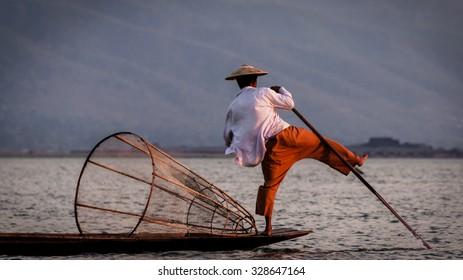 Inle Lake Fisherman rowing with foot Burma Myanmar