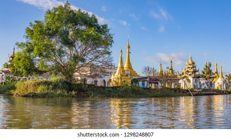 Inle Lake landscape with village pagoda with it's golden domes and spires in Myanmar, Burma