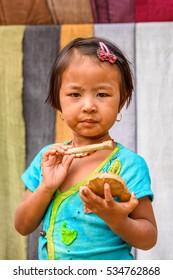 INLE LAKE, MYANMAR - AUG 30, 2016: Unidentified Burmese little girl in the street. 68 per cent of Myanma people belong to Bamar ethnic group
