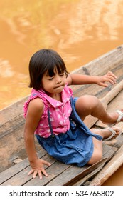 INLE LAKE, MYANMAR - AUG 30, 2016: Unidentified Burmese little girl on a wooden boat. 68 per cent of Myanma people belong to Bamar ethnic group