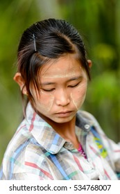 INLE LAKE, MYANMAR - AUG 30, 2016: Unidentified Burmese girl with a painted face. 68 per cent of Myanma people belong to Bamar ethnic group