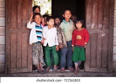 Inle lake, Myanmar - December 2014: Myanmar school children at the village school entrance at Inle lake, Myanmar