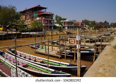 INLE LAKE, MYANMAR - FEB 28, 2015 - Tourist  long boats tied up to dock on   Inle Lake,  Myanmar (Burma)