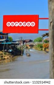 Inle Lake, Myanmar - Feb 7, 2018. Logo of Ooredoo at floating village in sunny day.