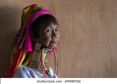 INLE LAKE, MYANMAR - JANUARY 10, 2015: Portrait of senior long-necked woman from Padaung (Kayan Lahwi) tribe wearing traditional brass coils on her neck. Padaung people are ethnic minority in Myanmar.