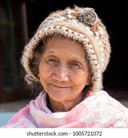 INLE LAKE, MYANMAR - JANUARY 11, 2016: Unidentified old woman in local market. The local people are hospitable and friendly to tourist in Burma, Myanmar
