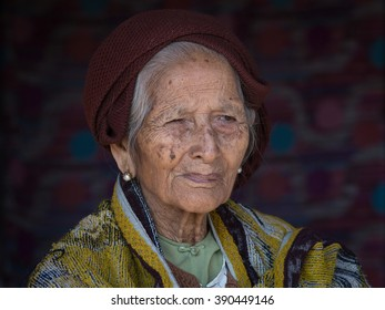 INLE LAKE, MYANMAR - JANUARY 13, 2016: Unidentified old woman in market. The local people are hospitable and friendly to tourists