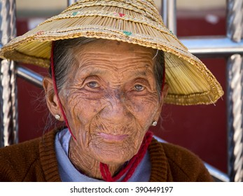 INLE LAKE, MYANMAR - JANUARY 14, 2016: Unidentified old woman in a straw hat . The local people are hospitable and friendly to tourists