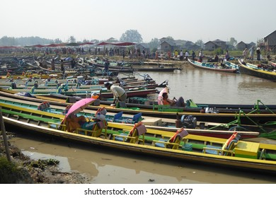 INLE LAKE, MYANMAR - MAR 1, 2015 - Long boats line the shore while their tourists explore  the weekly market on Inle Lake,  Myanmar (Burma)