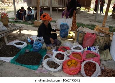 INLE LAKE, MYANMAR - MAR 1, 2015 - Woman selling fresh vegetables at the weekly market on  Inle Lake,  Myanmar (Burma)