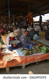 INLE LAKE, MYANMAR - MAR 1, 2015 - Man  selling cheroot cigars at the weekly market on  Inle Lake,  Myanmar (Burma)