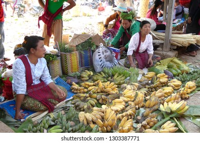 INLE LAKE, MYANMAR - MAR 1, 2015 - Woman selling bananas at the weekly market on  Inle Lake,  Myanmar (Burma)