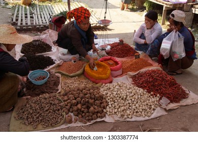 INLE LAKE, MYANMAR - MAR 1, 2015 - Young woman selling peppers and spices at the weekly market on  Inle Lake,  Myanmar (Burma)