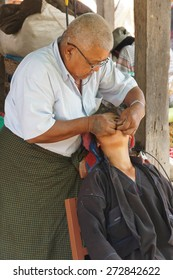 INLE LAKE, MYANMAR - MAR 1, 2015 - Dentist treats a patient at the weekly market, Inle Lake Myanmar (Burma)