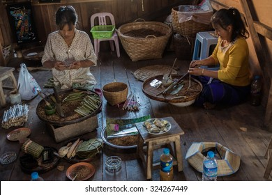 INLE LAKE, MYANMAR - NOVEMBER 23: Two ladies making cigars in a small traditional workshop at the Inle Lake. November 23 at Inle Lake, Shan State, Myanmar