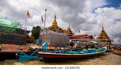 INLE LAKE, MYANMAR - Oct. 14 2018: Hpaung Daw U Pagoda in he center of the floating village with traditional boats parked around.