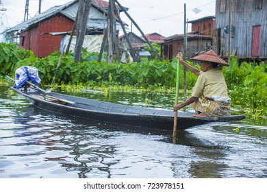 INLE LAKE , MYANMAR - SEP 07 : Intha woman on her boat in Inle lake Myanmar on September 07 2017 , inle Lake is a freshwater lake located in Shan state