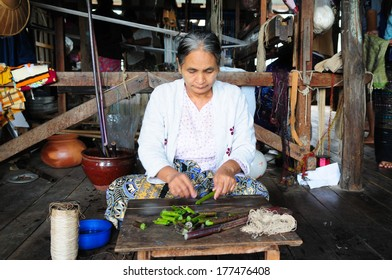 INLE LAKE, MYANMAR, SEPTEMBER 5: An unidentified Burmese woman make silk from lotus on September 5, 2013 in Inle Lake, Myanmar. Silk was produced from lotus is a speciality of Inle Lake area.