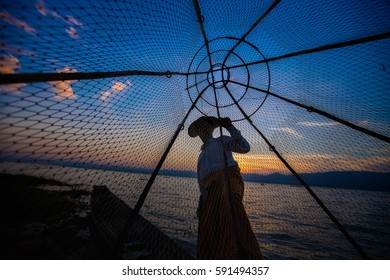 Inle Lake traditional fisherman with cone net