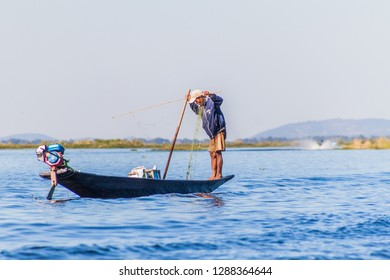 INLE, MYANMAR - NOVEMBER 26, 2016: Fisherman on a boat at Inle lake, Myanmar