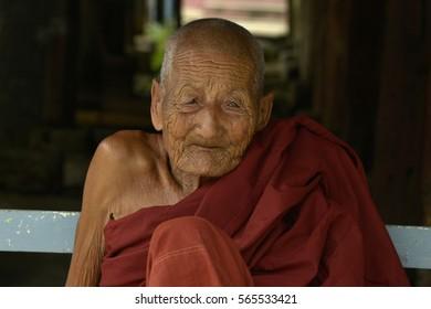 Inle, Myanmar - September - 9 - 2015 Old Buddhist monk in monastery