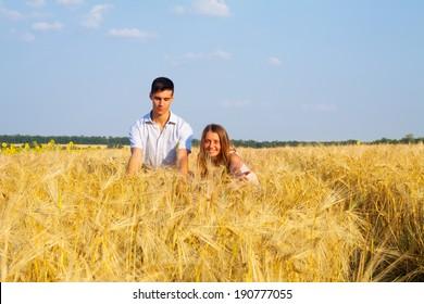 Inloved teen couple having fun on the wheat field